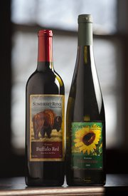"These wines, Buffalo Red and Traminette, from Somerset Ridge Vineyard and Winery in Miami County contain enough Kansas-grown grapes to be labeled ""Kansas"" wine. This 2009 file photo is from the Lawrence Journal-World."