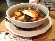 Sopa Port Fonda at Port Fonda, 4141 Pennsylvania Ave., Kansas City, Mo. The spicy dish features pork belly, shredded pork shoulder, fresh vegetables and a fried egg.
