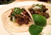 Tacos de Lengua are one of the best-selling dishes at Port Fonda, 4141 Pennsylvania Ave., Kansas City, Mo. The main ingredient is braised beef tongue, served street taco-style with spicy salsa, onion, cilantro and fresh lime.