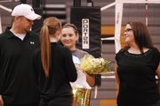 BLHS senior Haley Waters, joined by her parents, Dave and Debbie, receives flowers and gifts during Tuesday&#39;s senior night. 