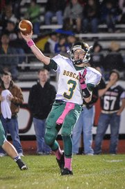 BLHS senior Zac Hevel attempts a pass during the Bobcats' 13-8 loss on Oct. 12 at Jefferson West.