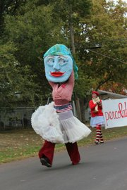 Douglas County Arts Caravan artist Rachael Perry dressed as a giant puppet for the EudoraFest parade.