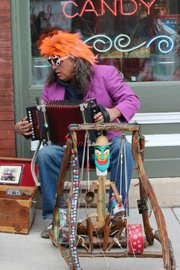 Douglas County Arts Caravan artist Tommee Sherwood plays the Boogalator, a percussion puppet, at EudoraFest.