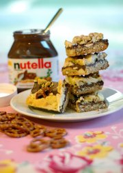 Sweet and salty come together in Pretzel-Nutella Bars with White Chocolate Chunks.