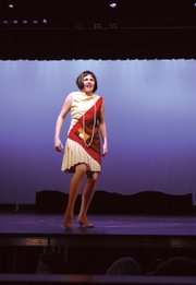 "Millie Dillmount, portrayed by Elizabeth Brooks, rallies after getting her purse and shoe stolen in ""Thoroughly Modern Millie."""