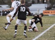 SMNW senior Cody Sliva makes a stop on the ball early against BV Northwest.