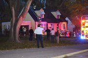 Shawnee firefighters respond to a house fire Thursday evening at 10430 W. 56th Terrace.