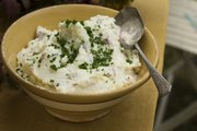 Sour cream and chive mashed potatoes, a classic side dish for Thanksgiving dinner.
