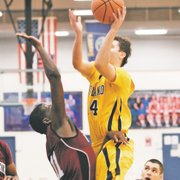 Brad Waterman draws a foul early against Wentworth Military Academy on Friday at Kansas City Kansas Community College. Waterman will receive plenty of opportunities to establish a role on his new team as Highland features a roster with just one sophomore.
