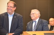 Shawnee Mayor Jeff Meyers, left, presented the city&#39;s planning director, Paul Chaffee, with an award for 35-years of municipal service during the Nov. 13 City Council meeting. The mayor, who arrived late for the meeting, found the parking lot filled as a result of the employee and volunteer service award presentations on the agenda and parking in a handicapped spot.