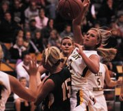 BLHS senior Jamie Johnson makes a pass near the basket.