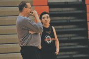 SMNW girls basketball coach Jeff Dickson visits with senior Anna King during a practice one evening last week.