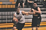 BLHS junior Chase Younger drives to the basket during last weeks Meet the Bobcats preseason scrimmage. Younger, and fellow junior J.P. Downing, will take on larger roles one season after breaking out in the state tournament as sophomores.