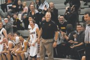 BSHS boys coach Dan Streit jumped off his sideline seat after senior Tyler Howell slammed down a buzzer-beating dunk in response to a failed dunk by BSHS alum Stevie Williams on Tuesday.
