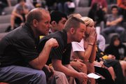 BLHS wrestling coach Tyler Cordts and assistant coach Ed Seaton look on during a match Thursday.