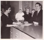 Marvin Rainey files for mayor in Overland Park in 1963 as his wife, Elisabeth, and sons Mark, left, and Ellis look on. He won the subsequent race, launching a long career in municipal government.