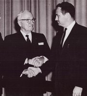 Prominent among Democrats in Johnson County and beyond, Rainey shakes hands with President Harry S. Truman.