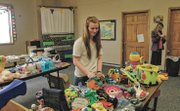 Katie Linsey, a junior at Mill Valley High School, organizes toys Saturday at GracePoint Church. The church's fourth annual toy drive, ongoing through Dec. 22, has had a lot of assistance this year from youth members of the church.