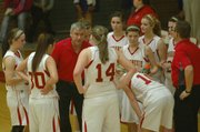 The Chieftain girls receive instruction from coach Randy Kraft during a timeout.
