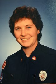 Joan Moore is pictured around 1985, two years after she became a volunteer firefighter with the Shawnee Fire Department. She became a paid member of the department in 1990.