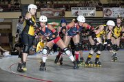 As this glmpse at a 2012 Victory Vixens bout shows, Kansas City Roller Warriors competition can get fierce.