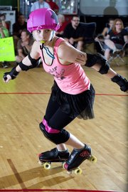 Meara Roach moves in for a collision during a Kansas City Roller Warriors Junior Derby bout.