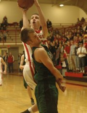 Blair Mathisen draws contact on his way to the basket.