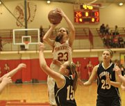 Jenny Whitledge shoots over Eudora's Emma Beck.