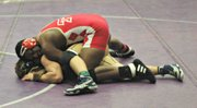 Julius Coats extended his win streak to eight matches and won his second straight 195-pound title.