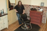 Jill Creason, owner of Story Hair Salon, 128 Oak St. Ste. A, decorated her salon in a shabby-chic style, with mirrors for the stylist stations mounted on old, distressed doors and other colorful furniture.