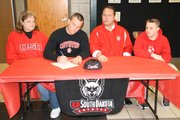 BLHS senior Drew Potter makes it official, signing his letter of intent on Wednesday to play football at South Dakota.