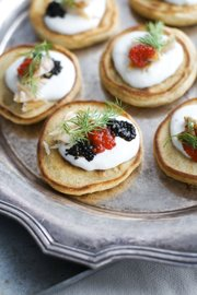 These elegant Blini with Smoked Trout, Caviar and Horseradish Cream make perfect hors doeuvres for an Oscar night viewing party.