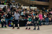 Matt Gurley, left, skates along beside derby players Liz Burns and Morgan Cartwright. Now in his third year as a roller derby referee, Gurley originally took up the activity for exercise.