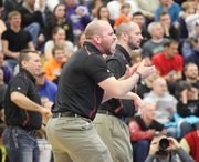 BSHS wrestling coach Brandon Jobe, left, shouts on from the sideline during the 21st annual KC Metro Classic on Tuesday at Kansas City Kansas Community College.