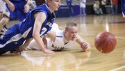 MVHS junior Wyatt Voorhes scrambles for a loose ball during the Jaguars&#39; 56-46 victory against Andover in the Class 5A state quarterfinals on Thursday, March 7 in Topeka.