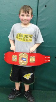 Braeden Moore won a 6-under state championship earlier this month, representing the Bobcat Wrestling Club.