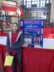 Kyah Surritte is show with her science project at the Greater Kansas City Science Fair last month at Union Station. Kyah project was chosen to be dipslayed in the 2013 Linda Hall Library Science Fair Project Display next month.