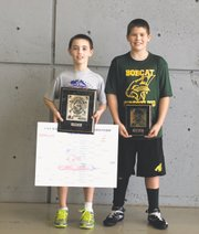 Ethan Cunning, left, and Peyton Reeves represented the Bobcat Wrestling Club on the medal stand Saturday at the Kansas State Wrestling Folkstyle Tournament in Topeka. Cunning capped a 42-0 season with a state title in his 8-and-under 76-pound bracket. Meanwhile, Reeves avenged a previous defeat to win his third-place match on Saturday.