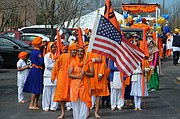 Holding the American flag, Harjit Dosanjh, a student at Blue Valley High School, prepares to lead the annual Sikh Vaisakhi Festival parade Saturday morning from the Kansas City Midwest Sikh Association Gurdwara in Shawnee.