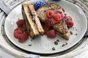 Chocolate-Stuffed French Toast with Raspberry Sauce is the perfect recipe to whip up for mom on Mother's Day. Using wheat bread ups the health value.
