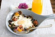 Skillet Garden Eggs with Fontina is inspired by egg-in-a-hat but calls for fresh vegetables in place of bread.
