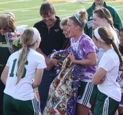 BLHS senior Kara Stephens receives her blanket made by the girls soccer team's underclassmen as part of her senior night gift. It is tradition, Stephens said, for the younger players to make an ugly blanket for seniors.