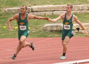 Basehor-Linwood's Trey Kincheloe hands off to Bryan Crowe in Friday's Class 4A boys 4x100-meter relay preliminaries in Wichita.