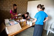 Lisa Buchholz (left) works in the pharmacy area at the clinic in Uganda.