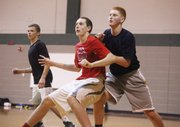 Pat Muldoon attempts to box out Carson Fliger during a recent BLHS boys basketball practice.