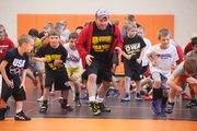 U.S. Olympian Ken Chertow leads a group of young wrestlers during a weeklong camp in May at SM Northwest.