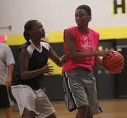 Kaliegh Taylor guards Abrise Sims during a recent BSHS girls basketball summer practice.