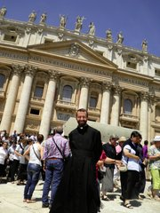 Father Nathan Haverland poses in front of St. Peter's Basilica at the Vatican following a Mass with Pope Benedict during his visit in 2011.
