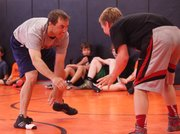 Colby Community College coach Brandon Jobe and BSHS senior Dominic Salvino square off during a June wrestling camp at BSHS.