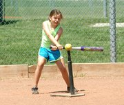 Gracie Drake takes a left-handed swing during last week's Chieftain Softball Camp.